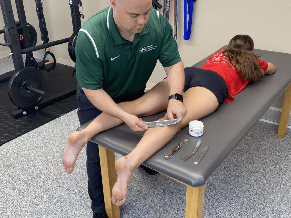 Graston Technique being performed on runner's calf