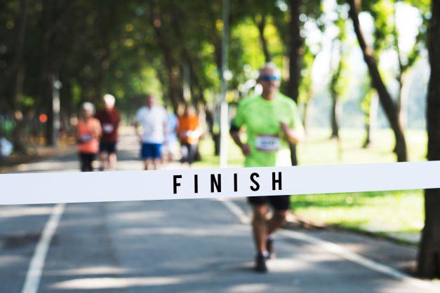 runner finishing race toledo